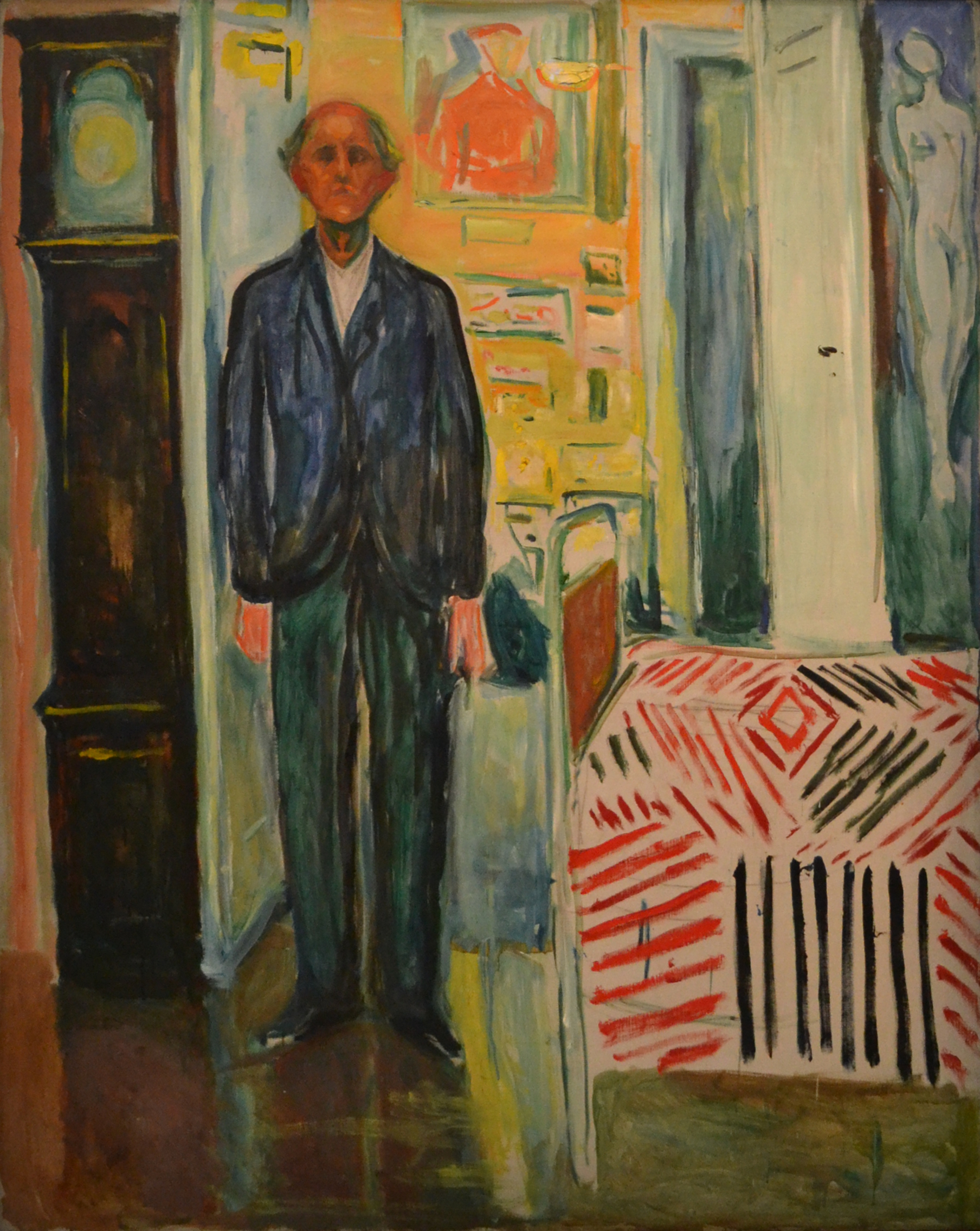 Edvard Munch: Self-Portrait. Between the Clock and the Bed. Oil on canvas, 1940-43. Photo © Munchmuseet